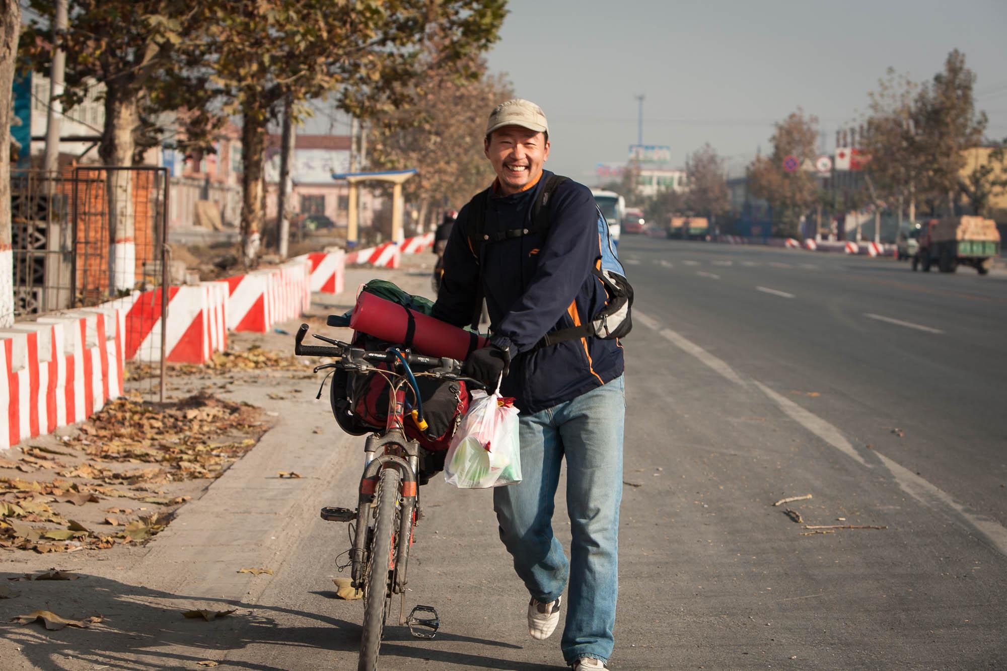 Zhu Hui pushing my backback on his bike