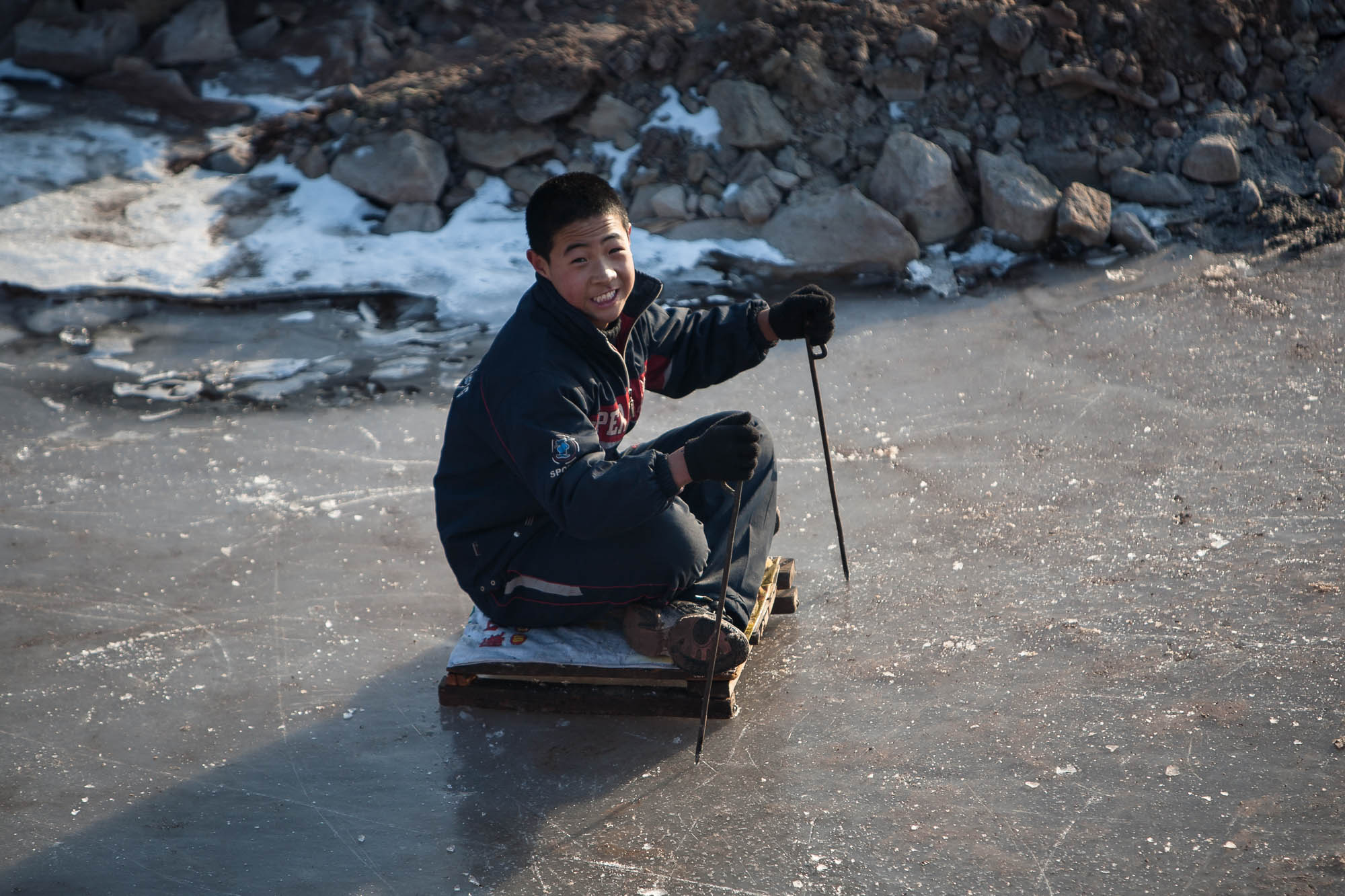 kid playing on the ice