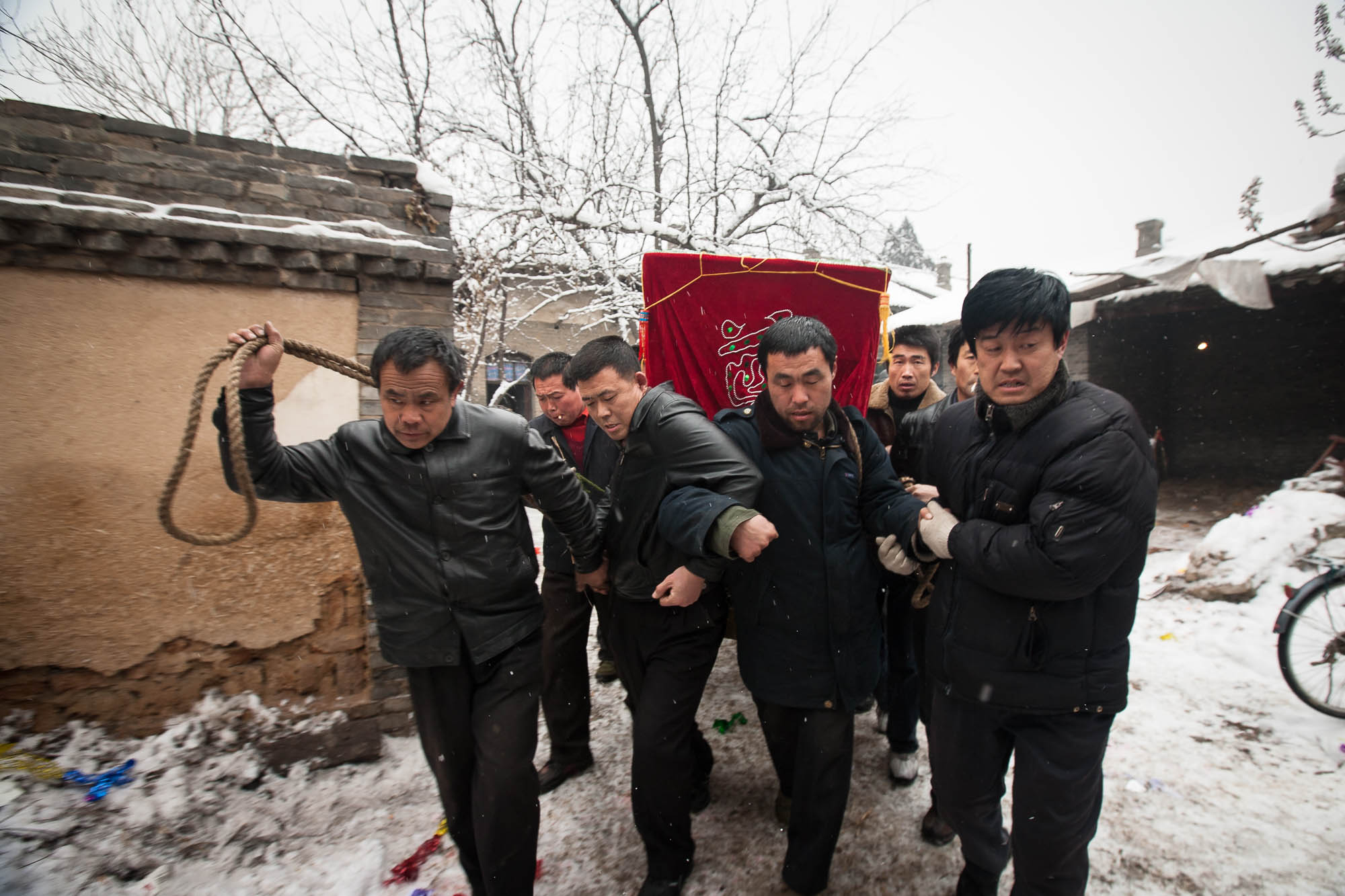 carrying the coffin