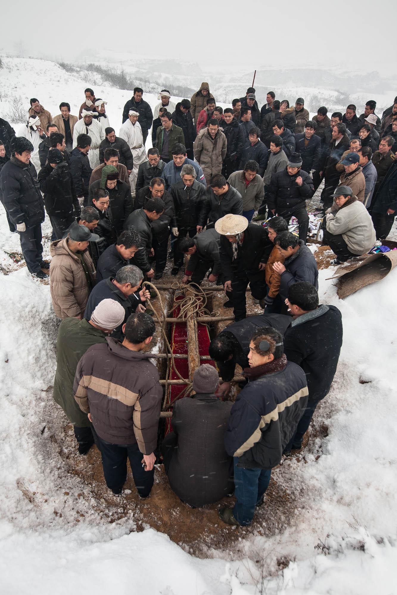 lowering the casket