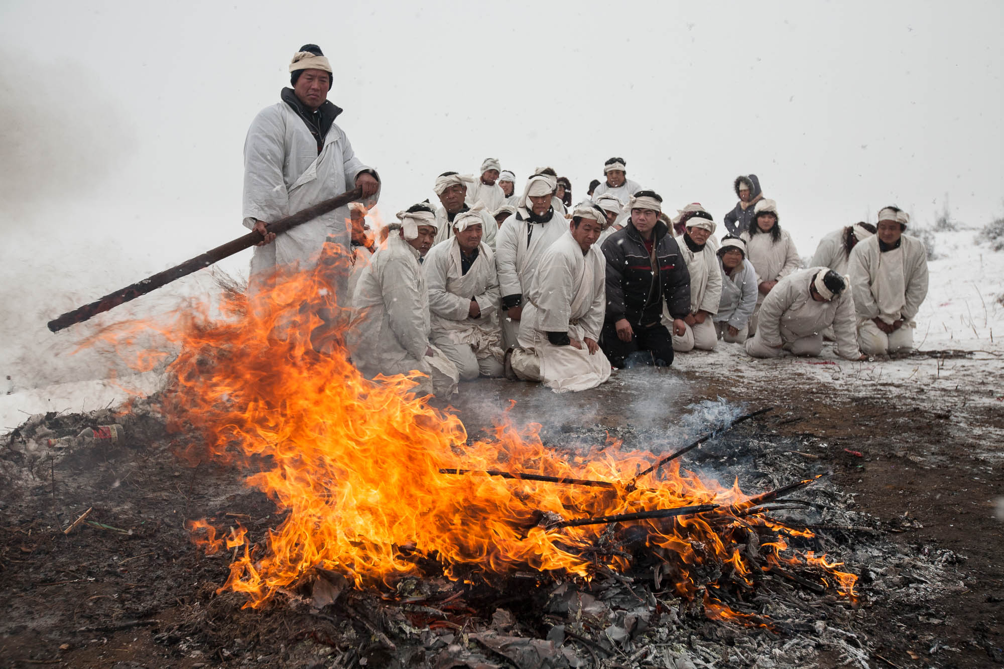 Traditional burial in the countryside. The mourning wreaths are being burned.