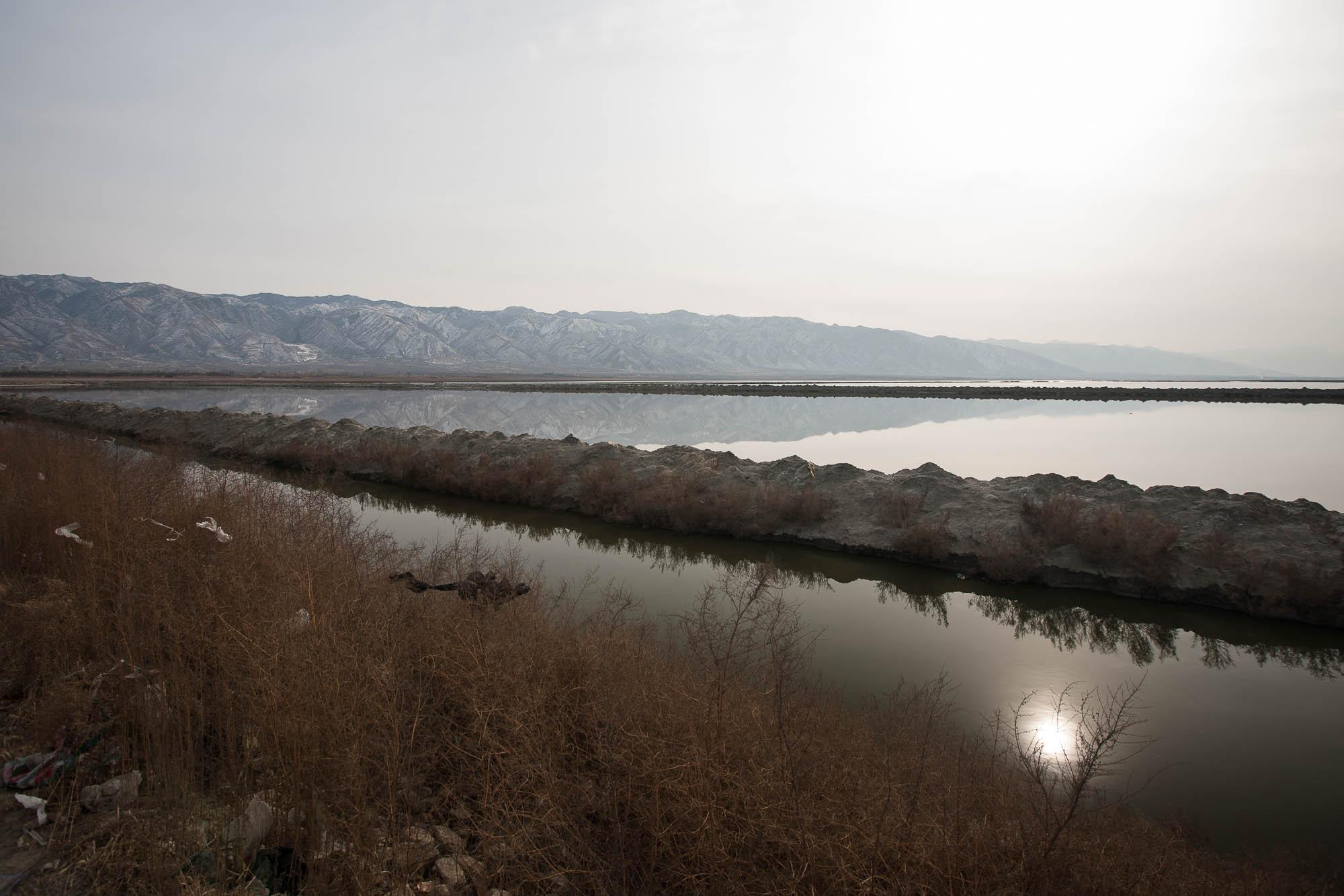 salt lake with mountains