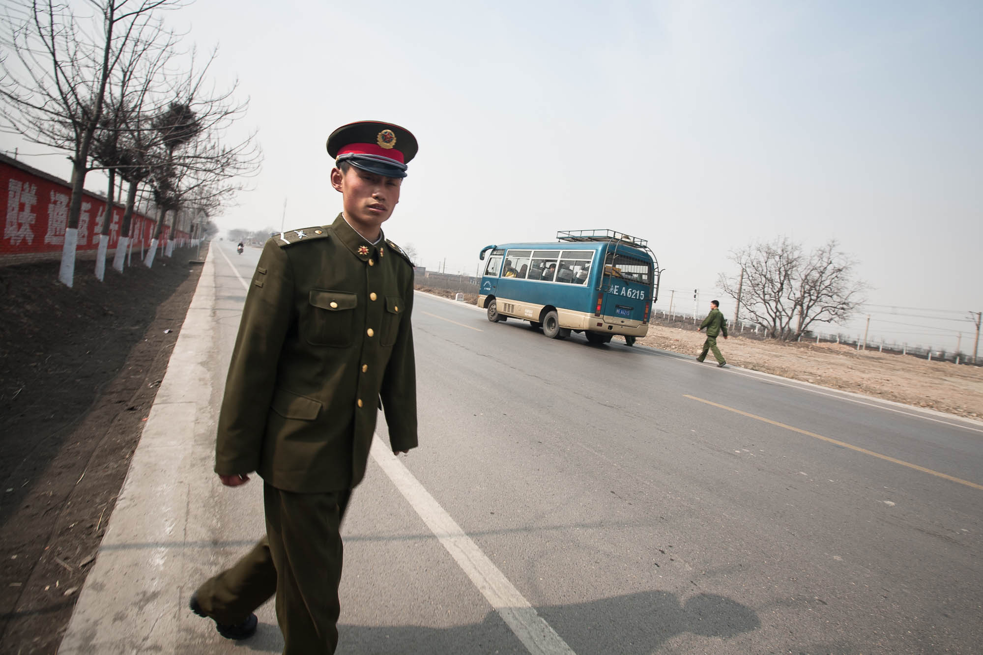 soldier and bus