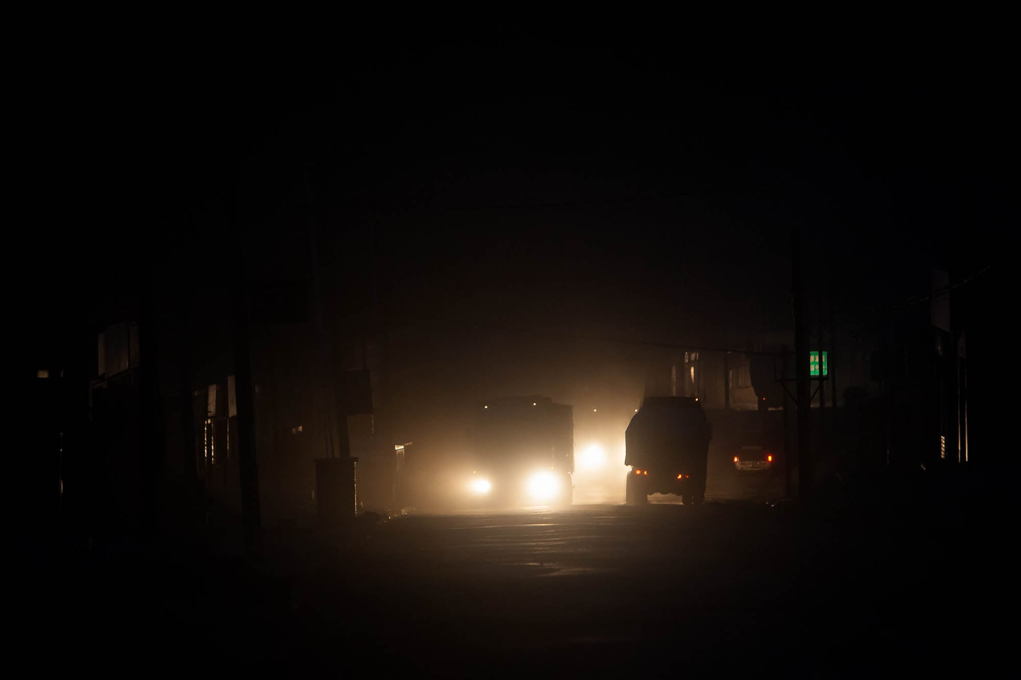 trucks in the darkness