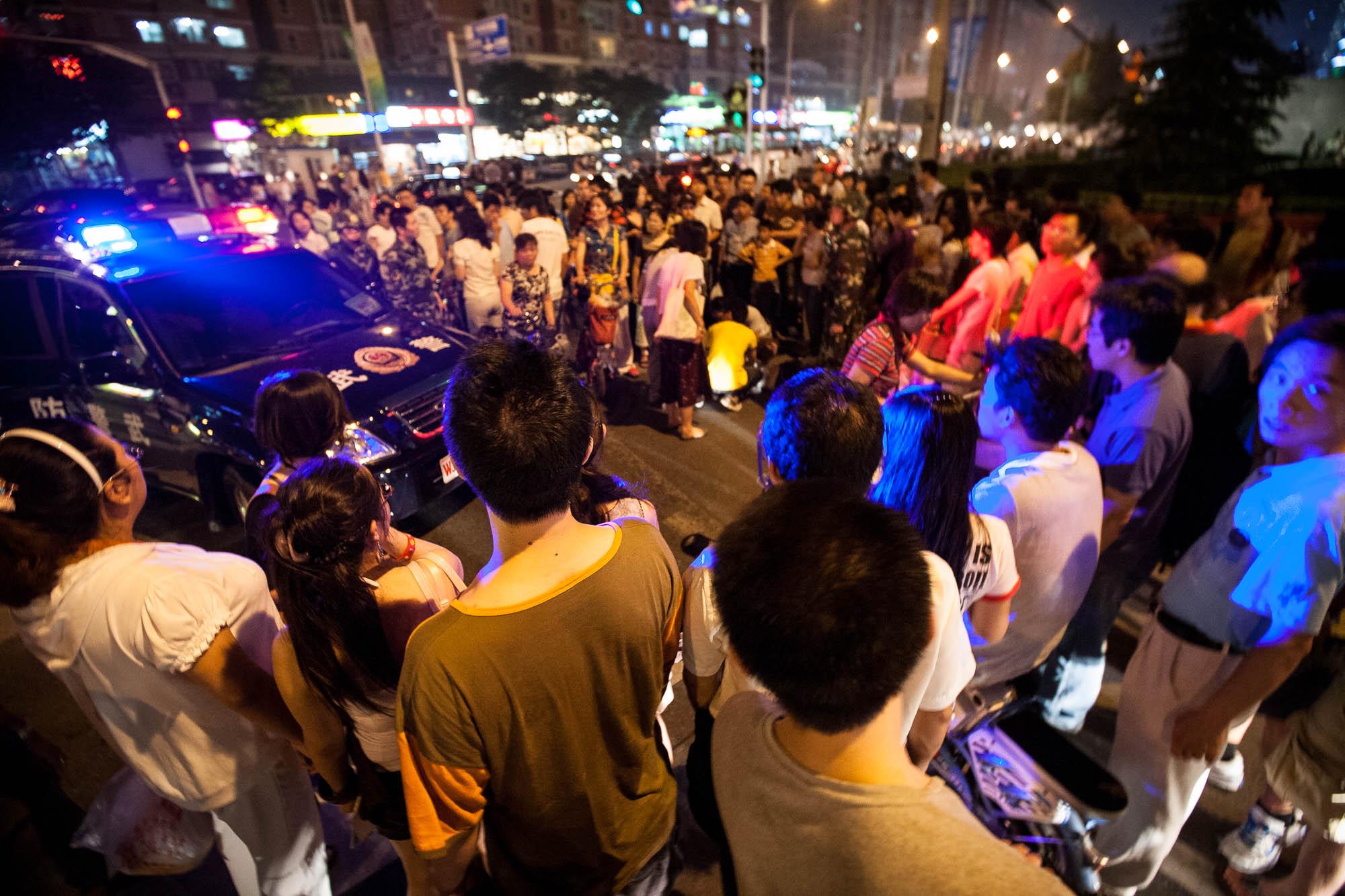 crowd gathering around accident