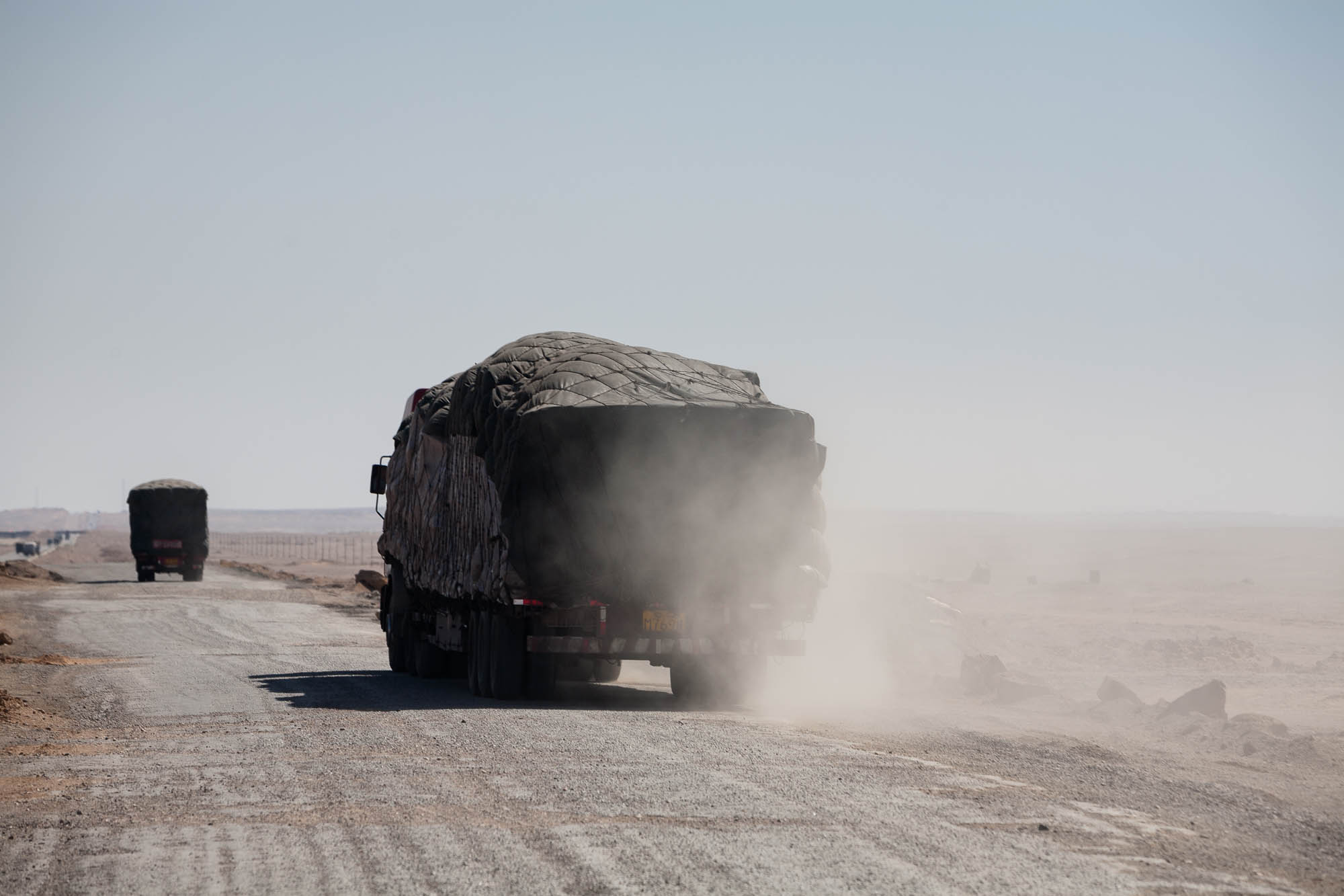 trucks in the dust