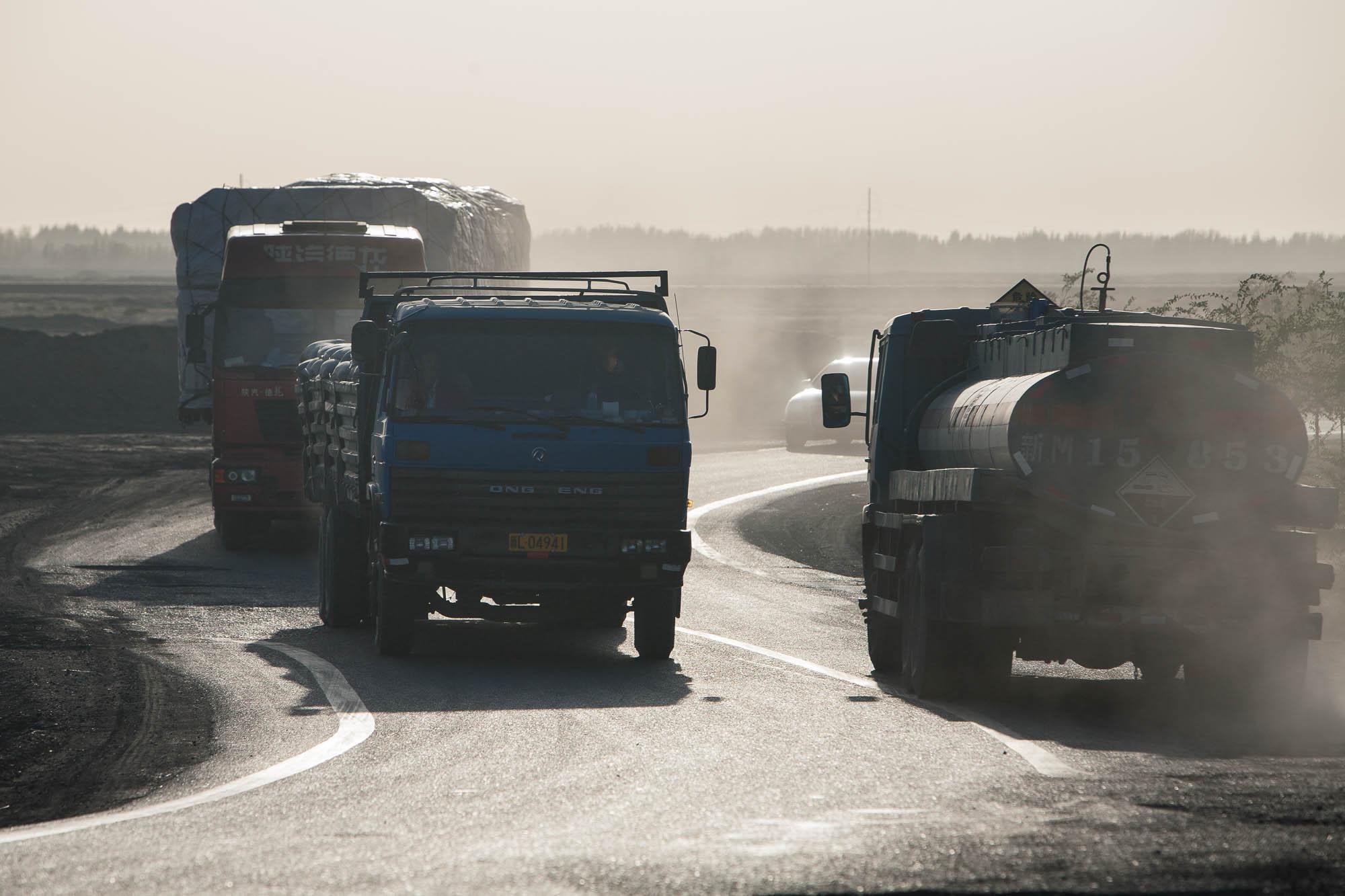 trucks on a curvy road