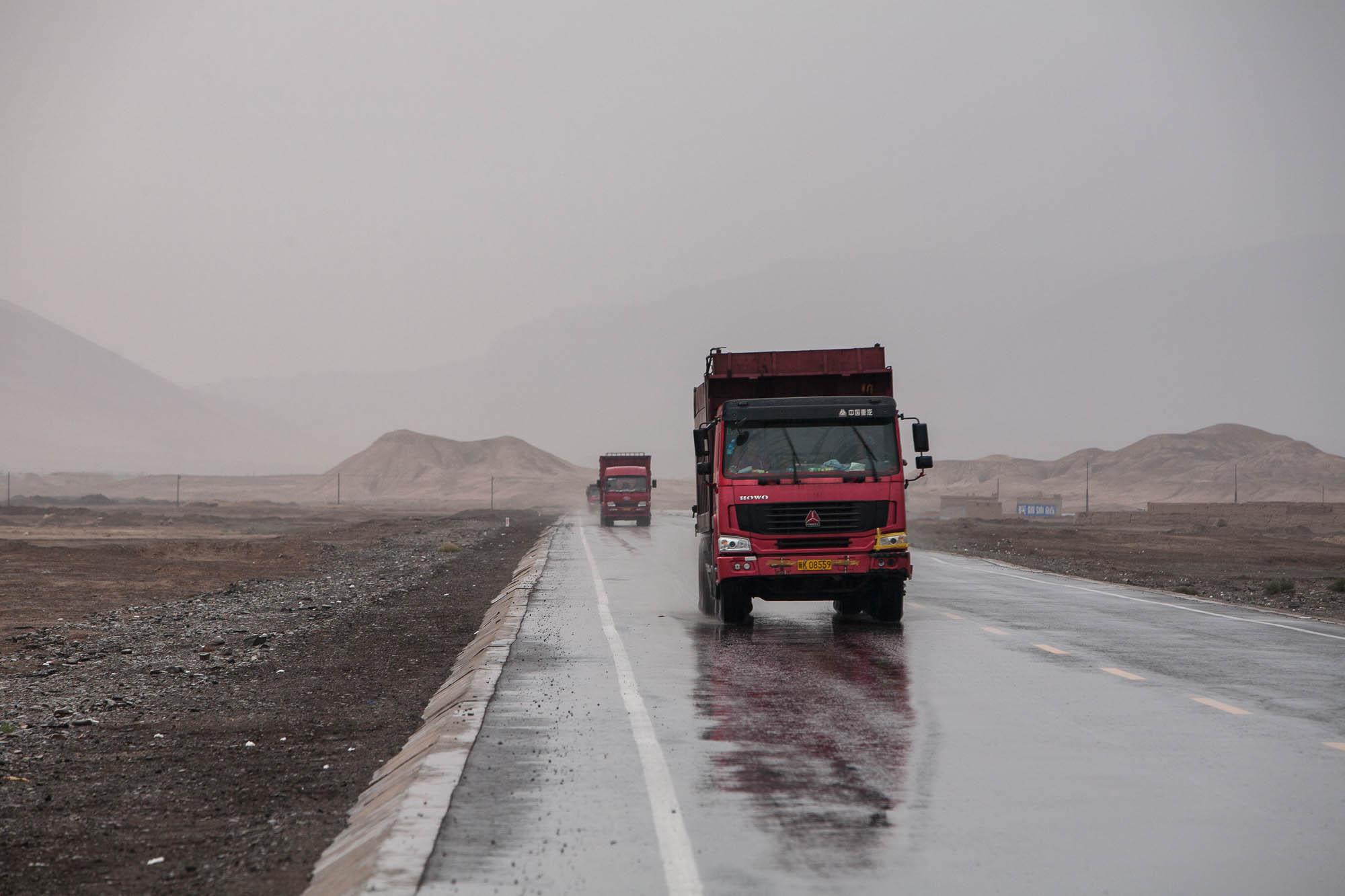 trucks in the rain