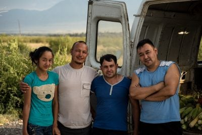These friendly Uyghurs insisted on giving me a corn cob on Augus