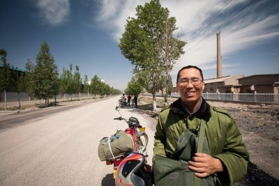 Chen Ping stopped his motorbike for a chat on June 10th, 2008