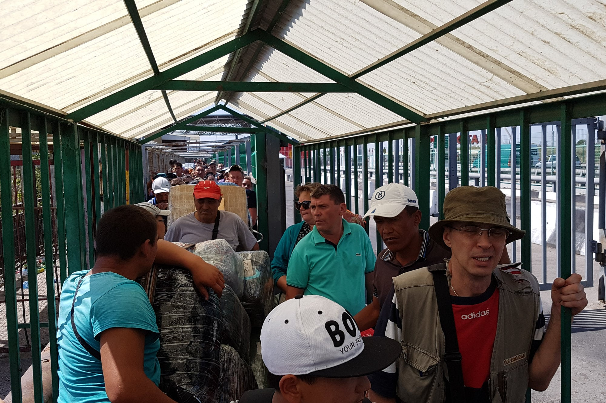 people waiting to cross into Kazakhstan