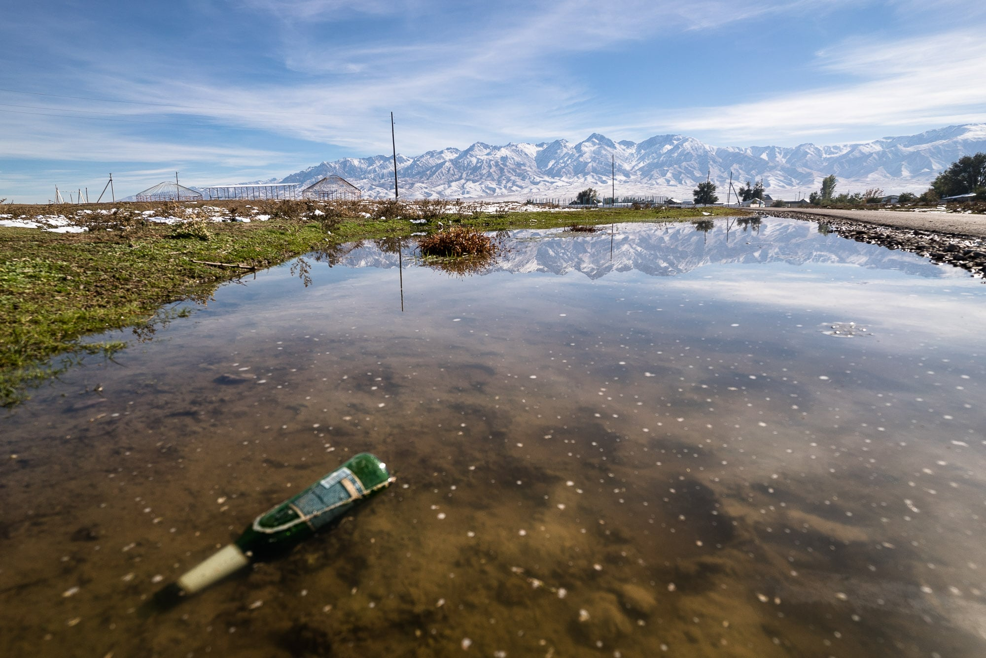 beer bottle and reflection and mountains