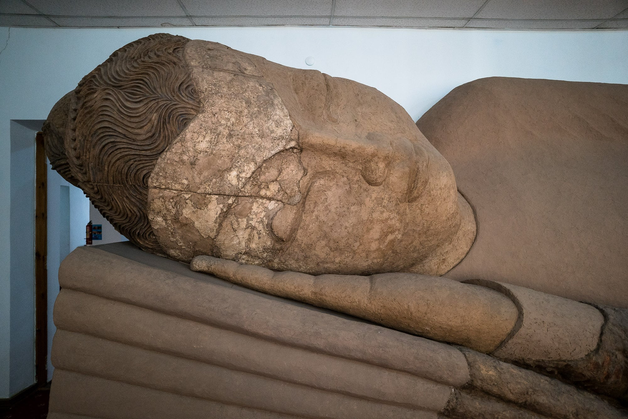 head of the Reclining Buddha in Dushanbe