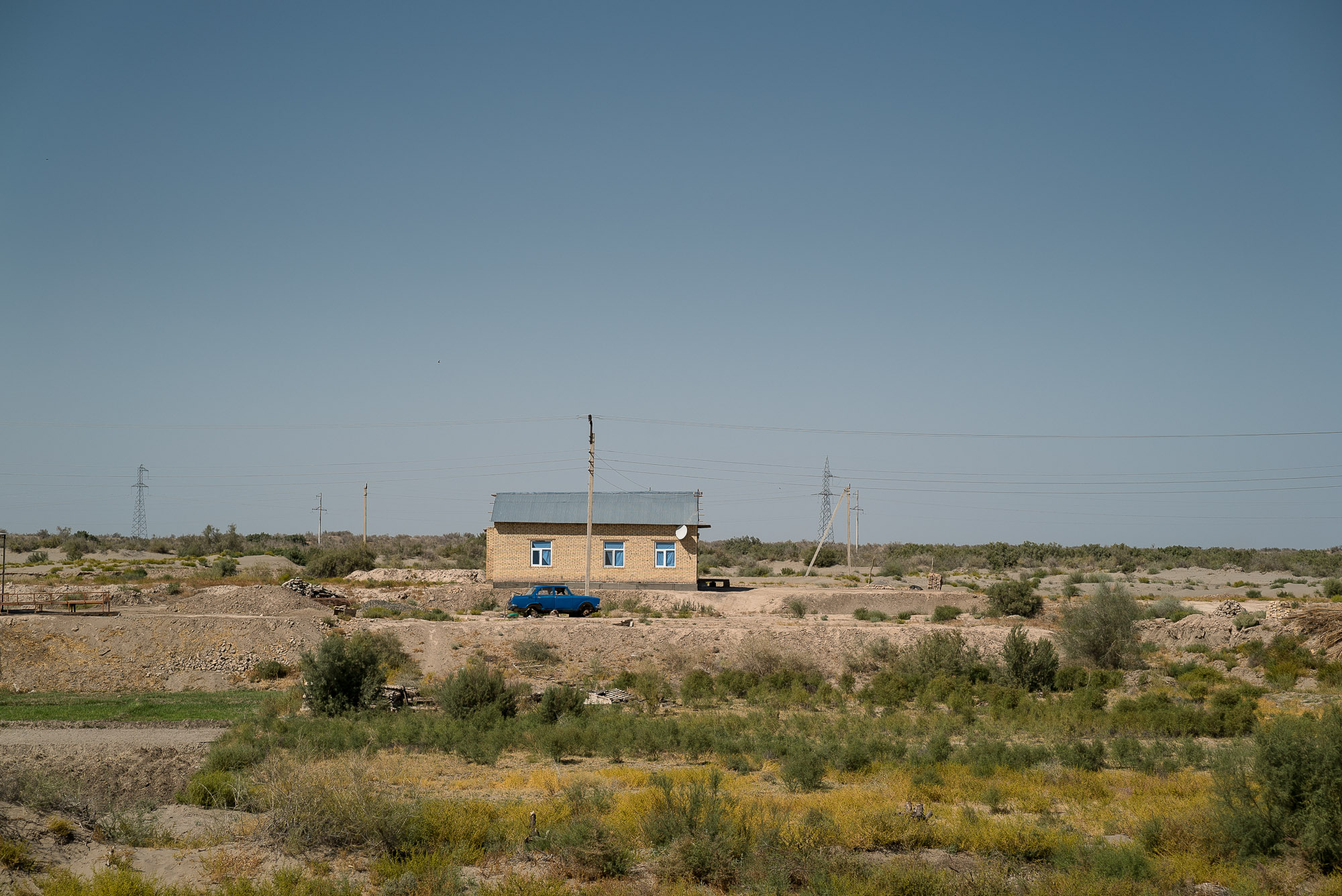 house with car near the Uzbek border