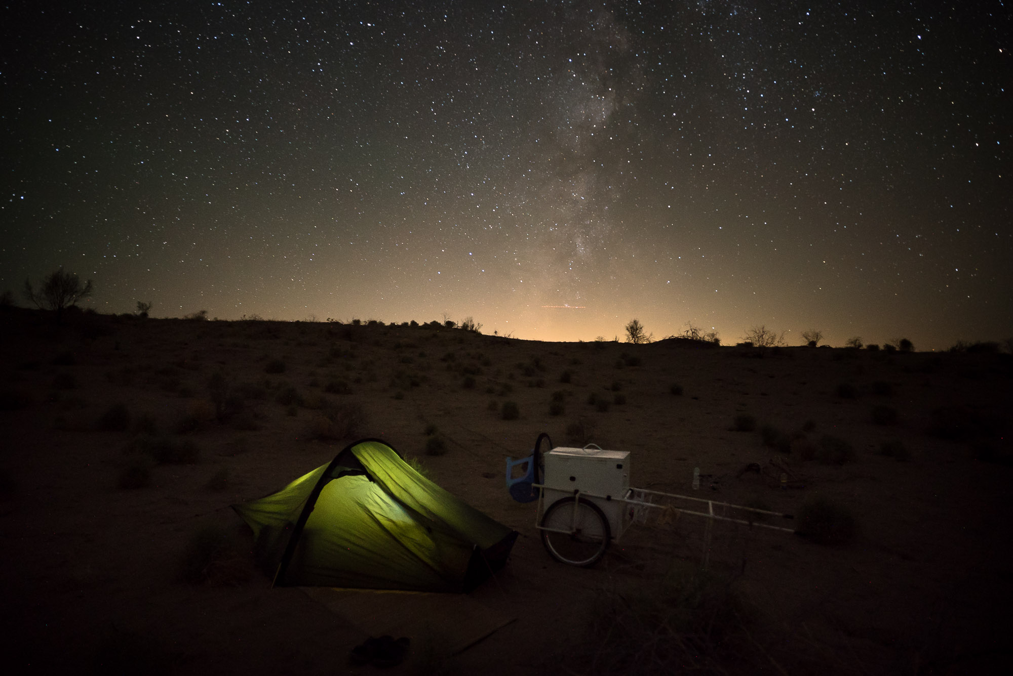 tent with light under milky way