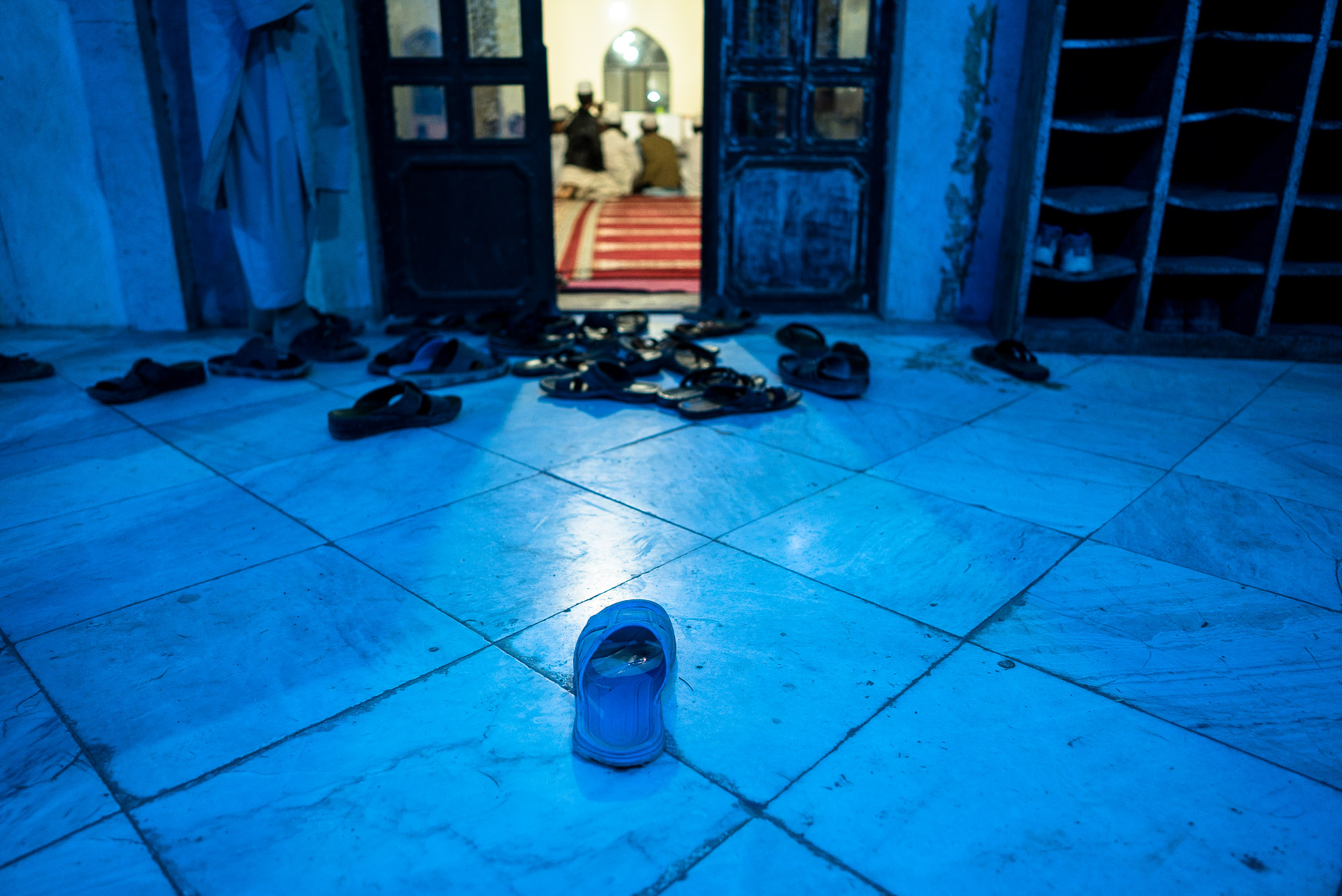 slippers outside of the madrasa