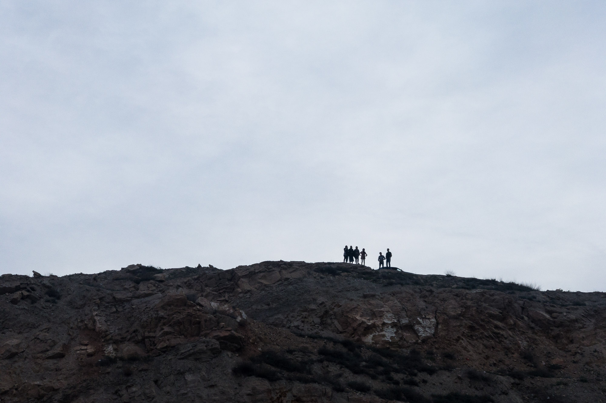 people on a hill
