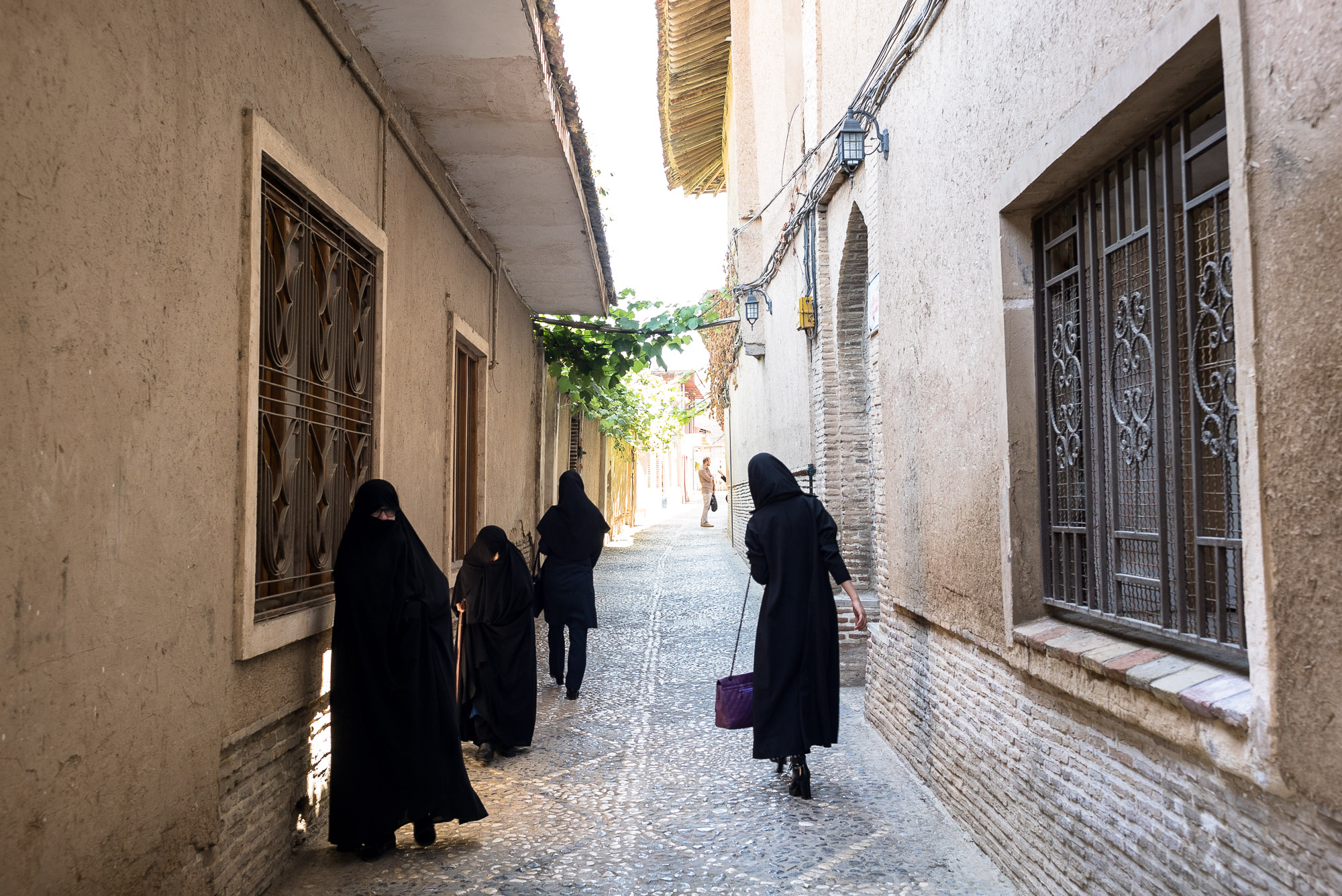women in an alley in Gorgan