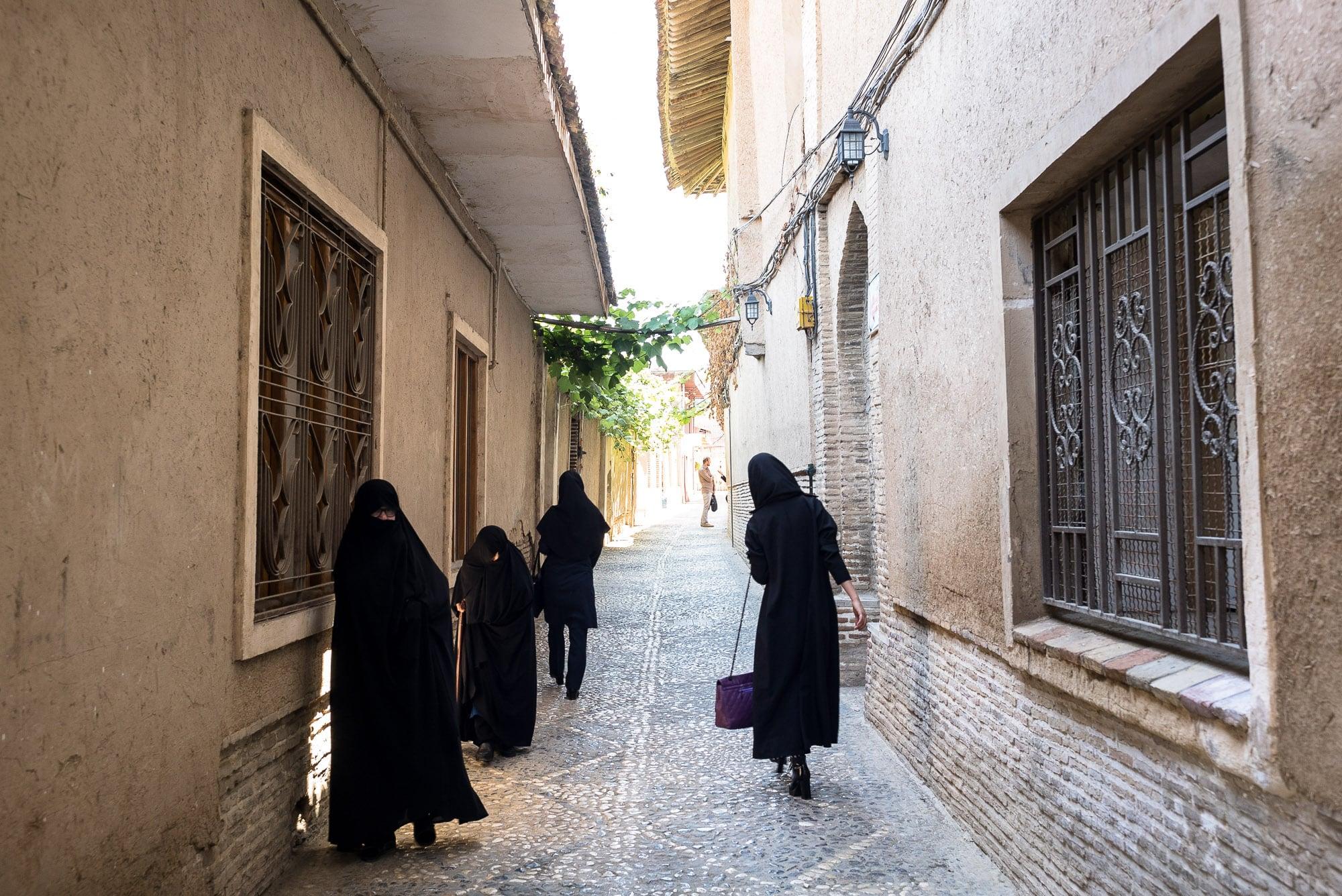 women in an alley in Gorgan