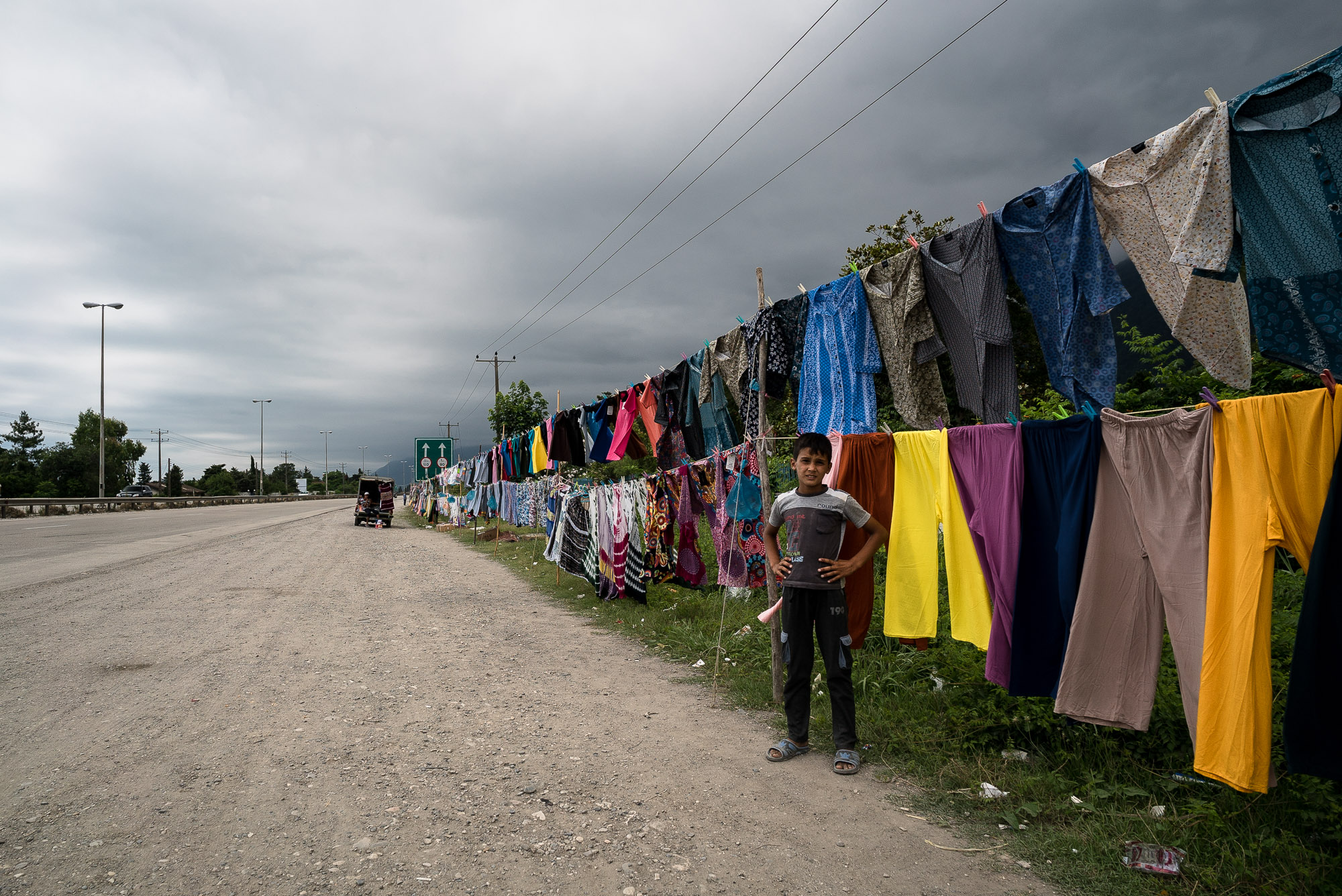 boy selling clothes