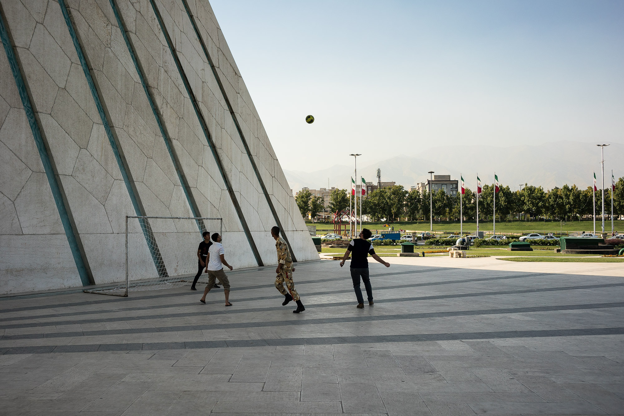 dudes playing football on Azari Square