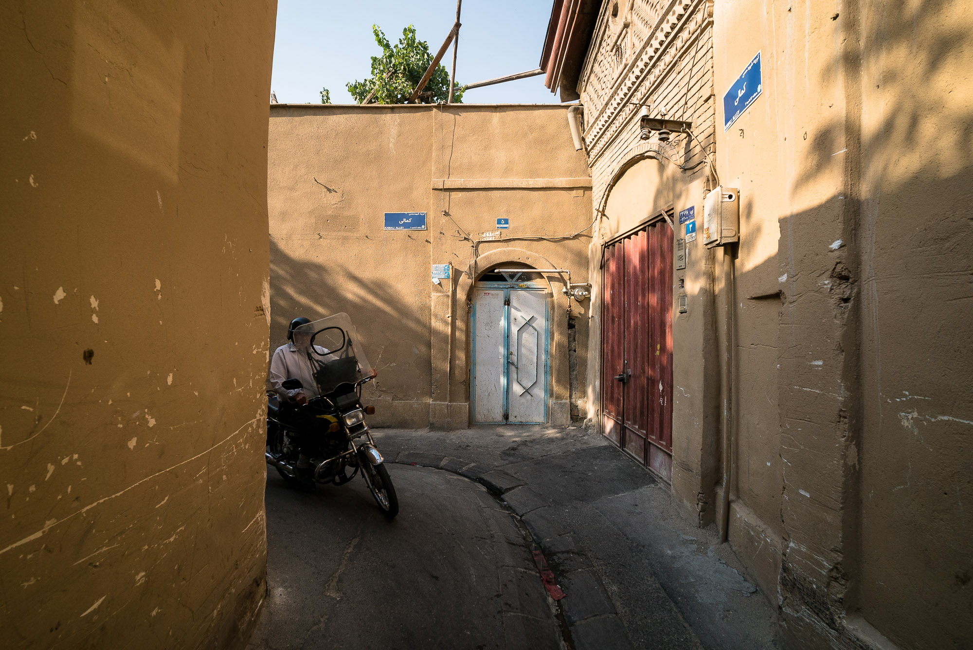 alley frequented by motorcyclists in old Tehran