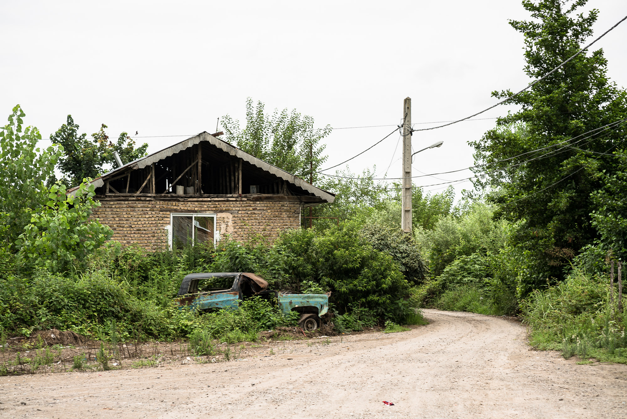 country house with broken car