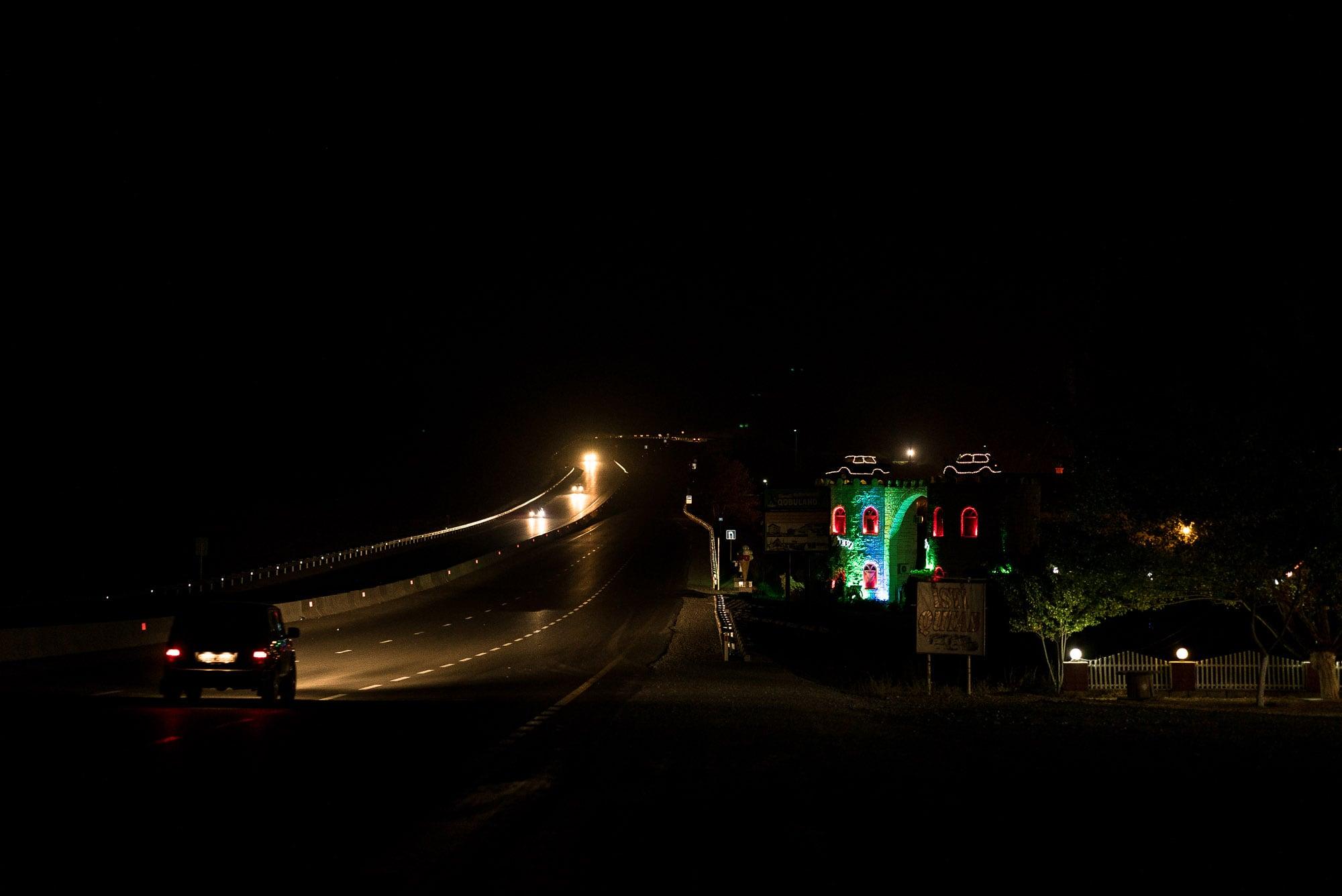 Qobuland at night