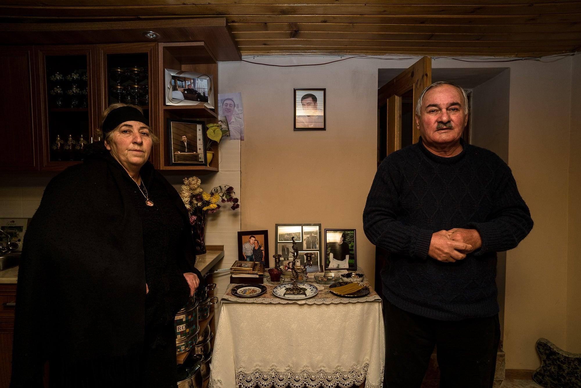Nino and Nugsari with pictures of Ramazi