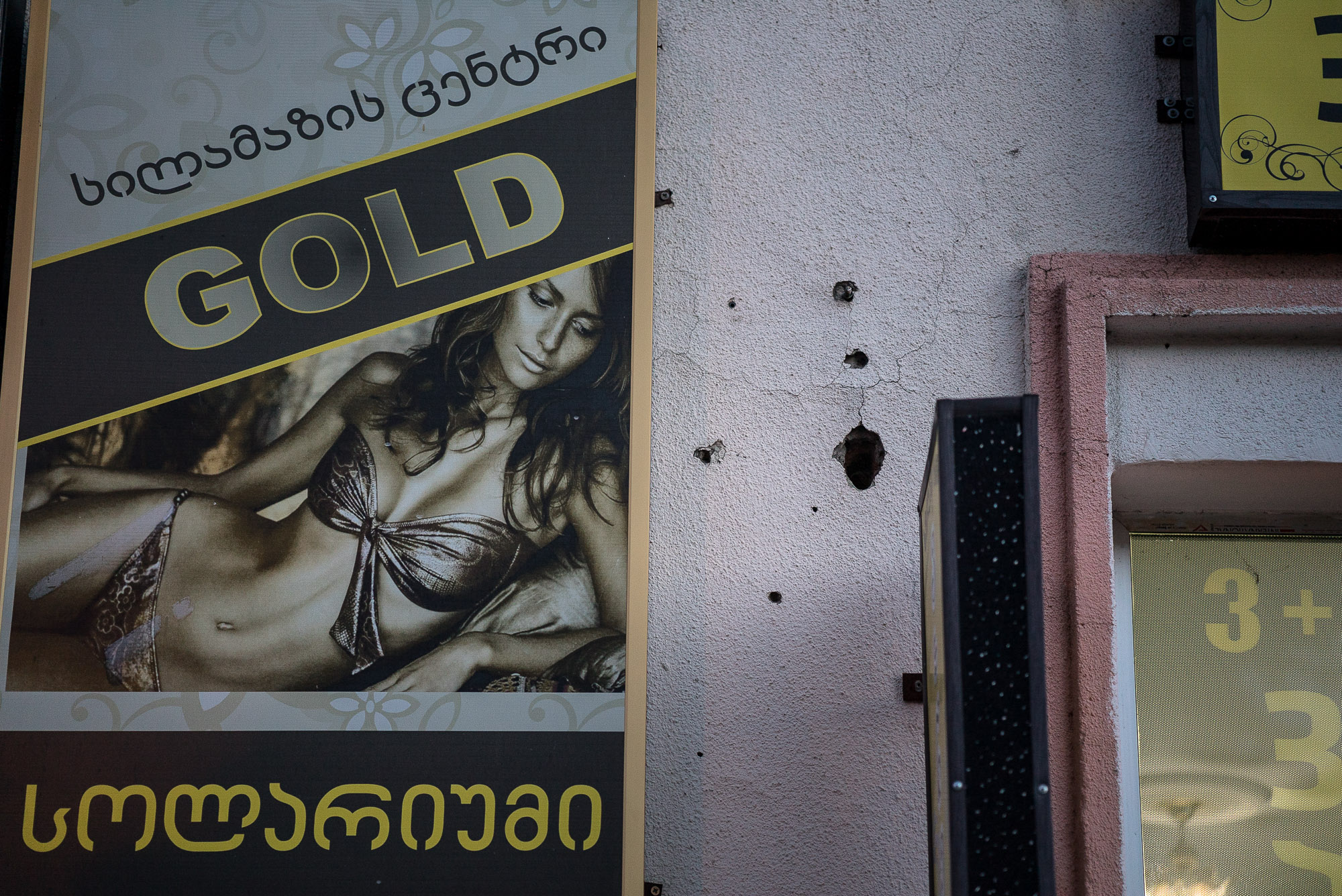 bullet holes next to a pawn shop