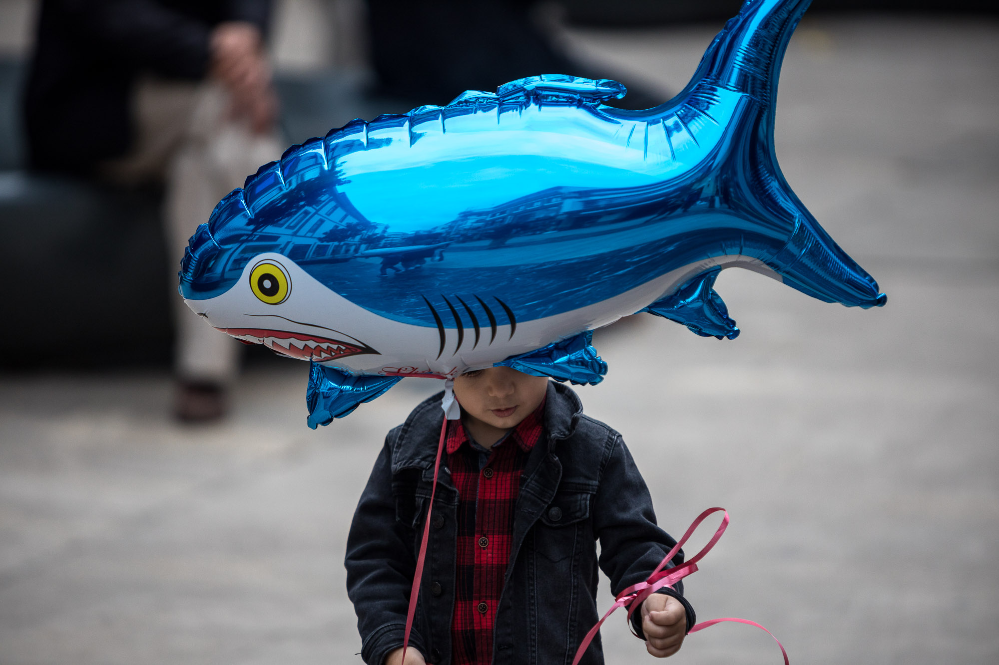 little dude with shark balloon