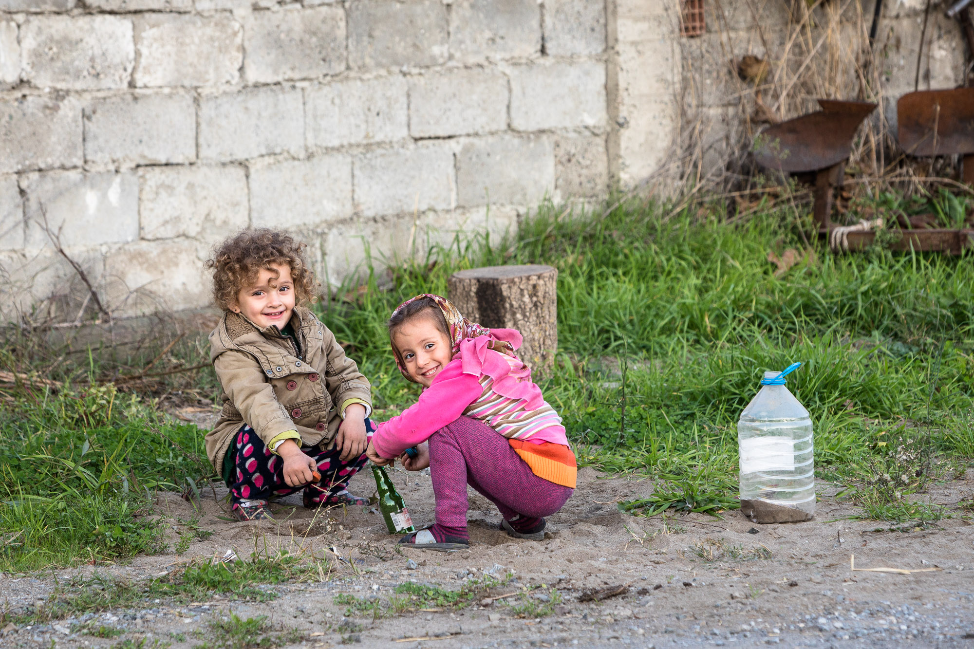 kids playing with a bottle